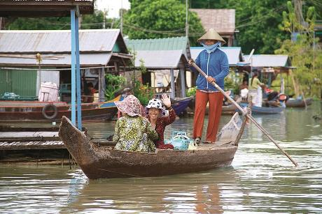 Visiting a floating village in Cambodia