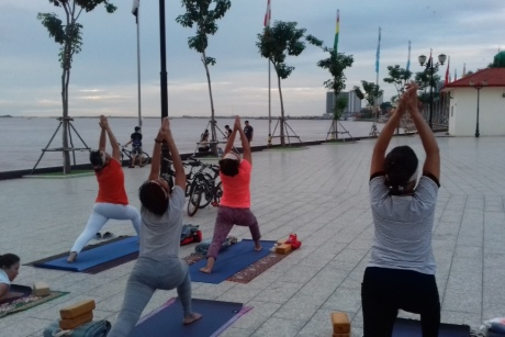 Morning yoga on the waterfront