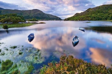Boats on water in Killarney National Park