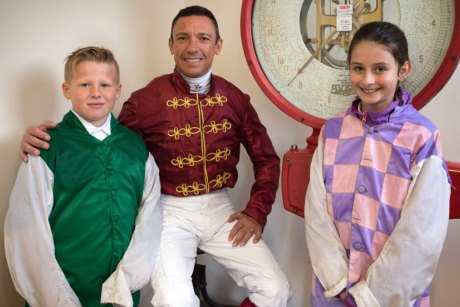 Students with a horseracing jockey.