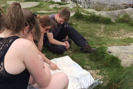 Pupils studying a map at Cwm Idwal, Northern Snowdonia.